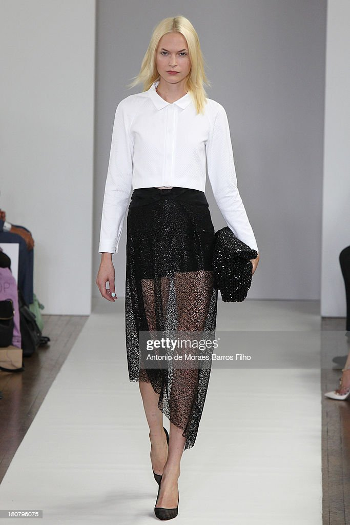 A model walks the runway at the Osman show during London Fashion Week SS14 on September 16, 2013 in London, England.