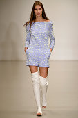 A model walks the runway at the Osman Spring Summer 2015 fashion show during London Fashion Week on September 16 2014 in London United Kingdom