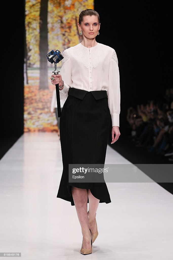A model walks the runway at the Oxana Fedorova fashion show during day three of Mercedes Benz Fashion Week Russia FW16/17 at Manege on March 13 2016...