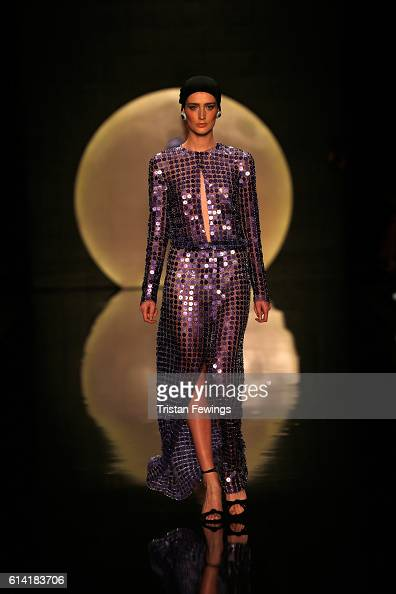 A model walks the runway at the Ozgur Masur show during MercedesBenz Fashion Week Istanbul at Zorlu Center on October 12 2016 in Istanbul Turkey