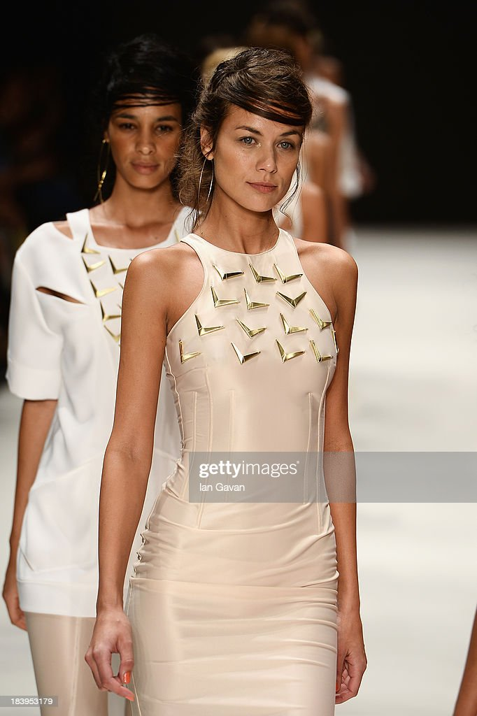 A model walks the runway at the Ozlem Kaya show during Mercedes-Benz Fashion Week Istanbul s/s 2014 Presented By American Express on October 10, 2013 in Istanbul, Turkey.