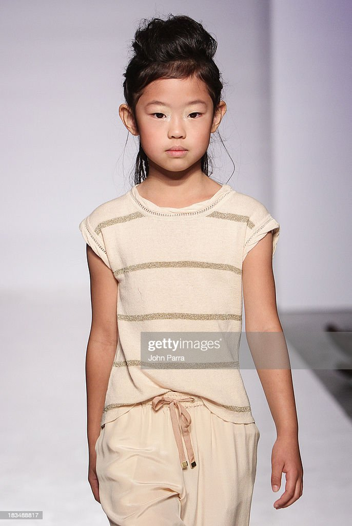 A model walks the runway at the Pale Cloud show during petiteParade NY Fashion Week in Collaboration with Voguebambini at the Industria Superstudio on October 6, 2013 in New York City.