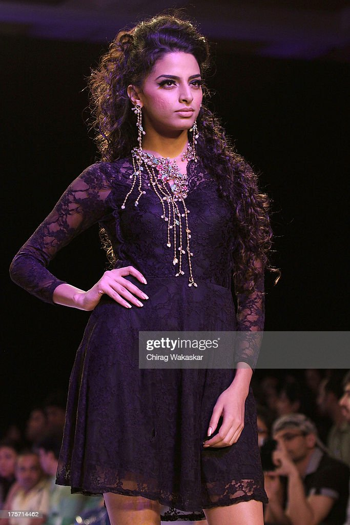 A model walks the runway at the Pallavi Foley show on day 3 of India International Jewellery Week 2013 at the Hotel Grand Hyatt on August 6, 2013 in Mumbai, India.