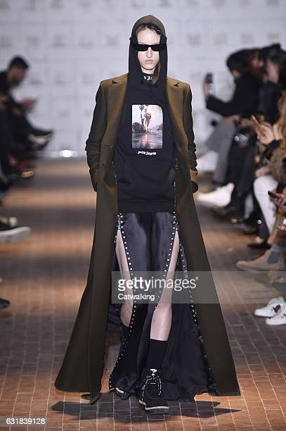 A model walks the runway at the Palm Angels Autumn Winter 2017 fashion show during Milan Menswear Fashion Week on January 16 2017 in Milan Italy