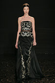 A model walks the runway at the Pamella Roland Fall 2013 fashion show during MercedesBenz Fashion Week at The Studio at Lincoln Center on February 11...