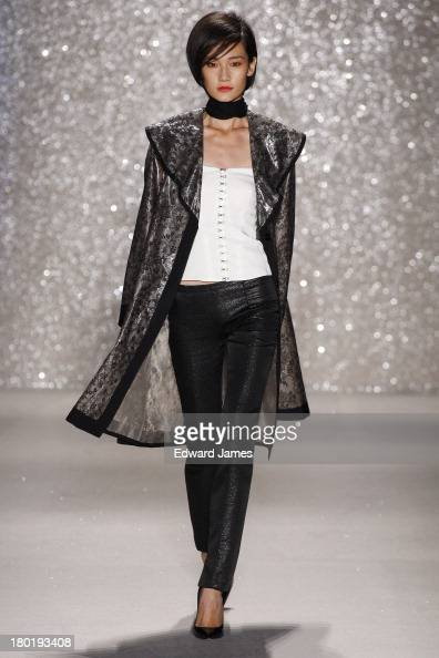 A model walks the runway at the Pamella Roland show during Spring 2014 MercedesBenz Fashion Week at The Studio at Lincoln Center on September 9 2013...