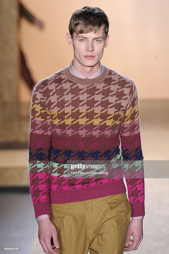 A model walks the runway at the Paul Smith Autumn Winter 2013 fashion show during Paris Menswear Fashion Week on January 20, 2013 in Paris, France.