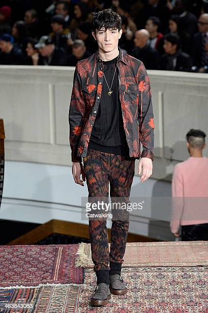 A model walks the runway at the Paul Smith Autumn Winter 2014 fashion show during Paris Menswear Fashion Week on January 19 2014 in Paris France
