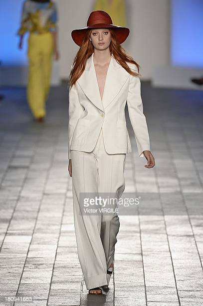 A model walks the runway at the Paul Smith show during London Fashion Week Spring Summer 2014 on September 15 2013 in London England