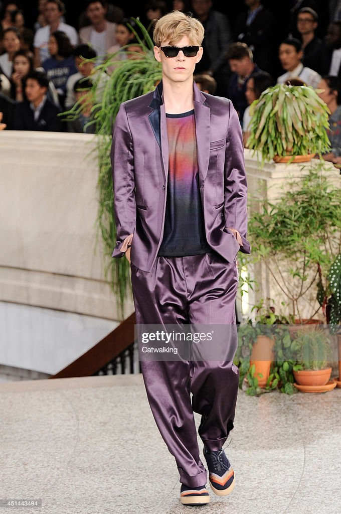 A model walks the runway at the Paul Smith Spring Summer 2015 fashion show during Paris Menswear Fashion Week on June 29, 2014 in Paris, France.
