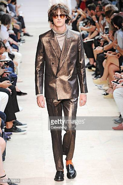 A model walks the runway at the Paul Smith Spring Summer 2016 fashion show during Paris Menswear Fashion Week on June 28 2015 in Paris France