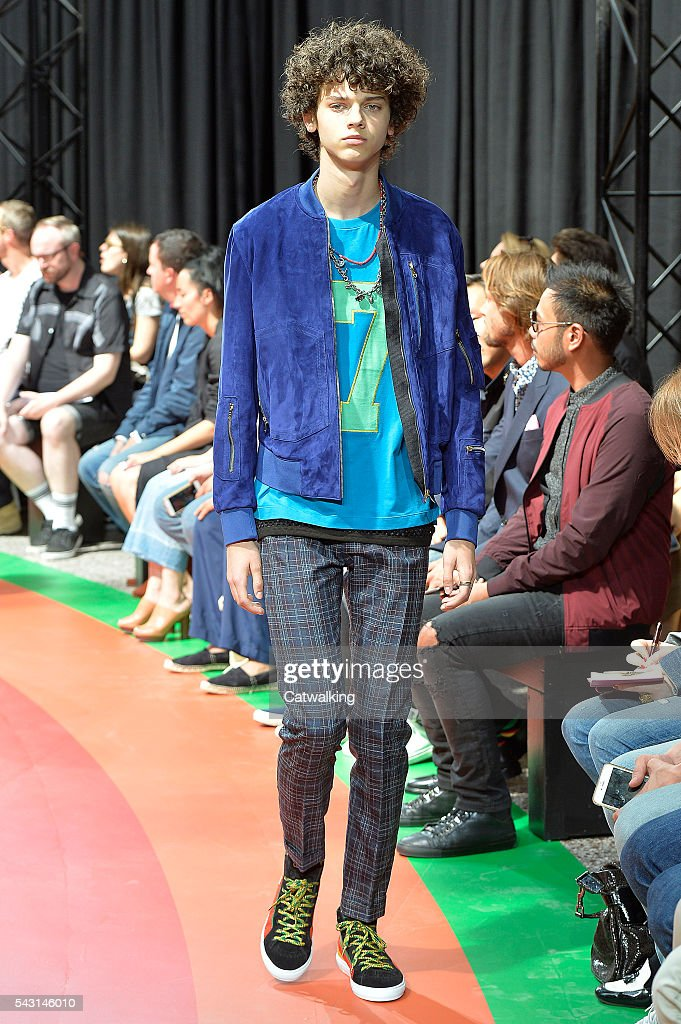 A model walks the runway at the Paul Smith Spring Summer 2017 fashion show during Paris Menswear Fashion Week on June 26, 2016 in Paris, France.