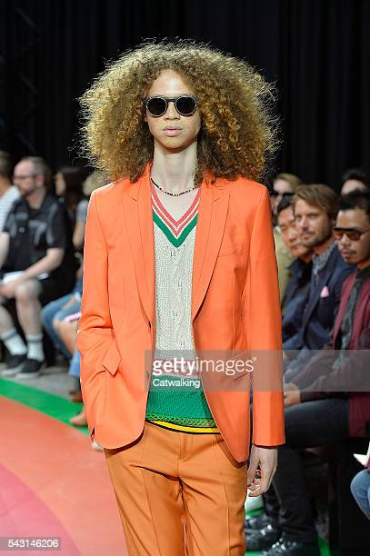 A model walks the runway at the Paul Smith Spring Summer 2017 fashion show during Paris Menswear Fashion Week on June 26 2016 in Paris France
