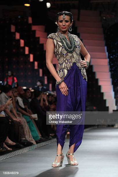 A model walks the runway at the PCJ Grand Finale show of India International Jewellery Week 2012 day 5 at the Grand Hyatt on August 23 2012 in Mumbai...