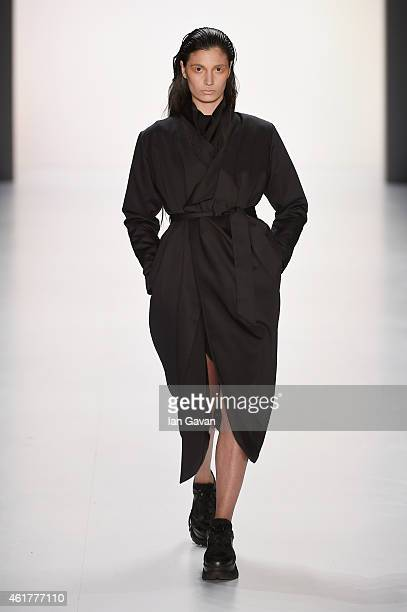 A model walks the runway at the Pearly Wong show during the MercedesBenz Fashion Week Berlin Autumn/Winter 2015/16 at Brandenburg Gate on January 19...