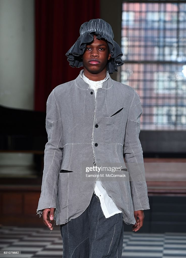 A model walks the runway at the PENG TAI - LCF MA17 show during London Fashion Week Men's January 2017 collections at St John's Smith Square on January 6, 2017 in London, England.