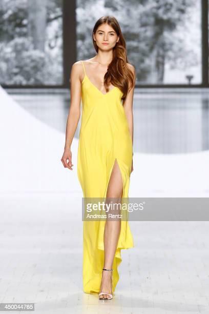 A model walks the runway at the Perret Schaad show during MercedesBenz Fashion Days Zurich 2013 on November 16 2013 in Zurich Switzerland