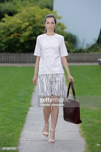 A model walks the runway at the Perret Schaad show during the MercedesBenz Fashion Week Spring/Summer 2015 at Kronprinzenpalais on July 10 2014 in...