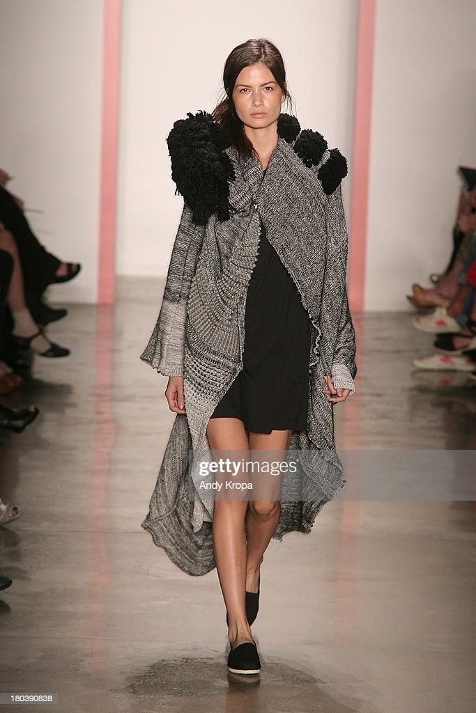 A model walks the runway at the Phase 2 Parsons and MFA fashion design fashion show during MADE Fashion Week Spring 2014 at Milk Studios on September...