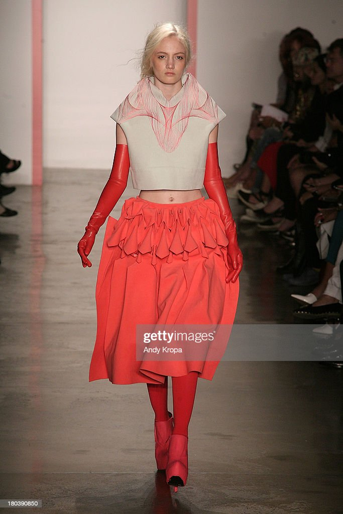 A model walks the runway at the Phase 2 Parsons and MFA fashion design fashion show during MADE Fashion Week Spring 2014 at Milk Studios on September 12, 2013 in New York City.