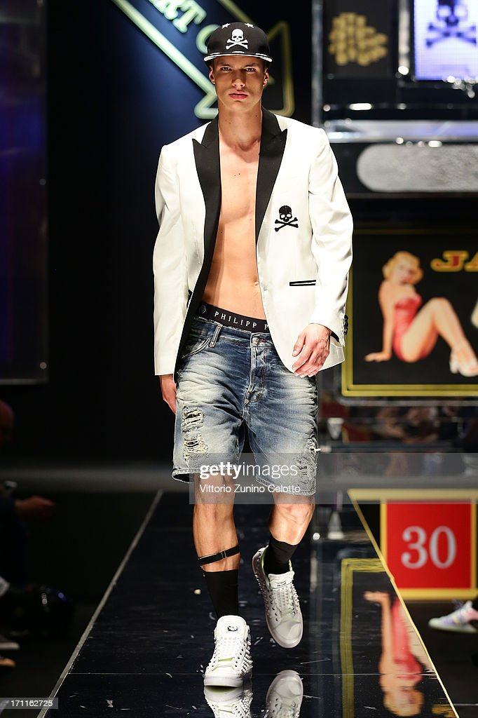 A model walks the runway at the Philipp Plein show during Milan Menswear Fashion Week Spring Summer 2014 on June 22, 2013 in Milan, Italy.