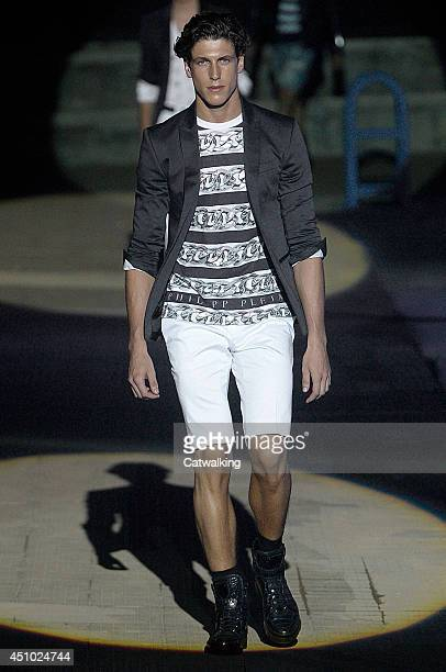 A model walks the runway at the Philipp Plein Spring Summer 2015 fashion show during Milan Menswear Fashion Week on June 21 2014 in Milan Italy