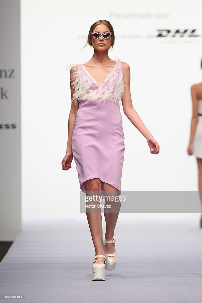 A model walks the runway at the Pink Magnolia Spring/Summer 2014 collection during the third day of Mercedes-Benz Fashion Week Mexico at Campo Marte on September 27, 2013 in Mexico City, Mexico.