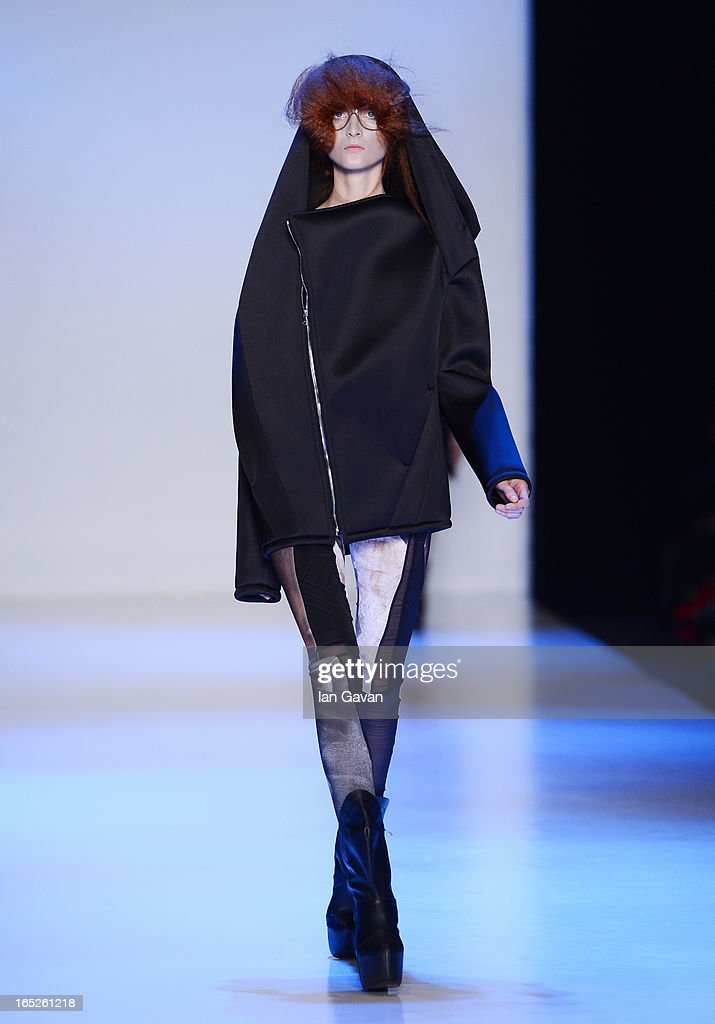 A model walks the runway at the Pirosmani by Jenya Malygina show during Mercedes-Benz Fashion Week Russia Fall/Winter 2013/2014 at Manege on April 2, 2013 in Moscow, Russia.
