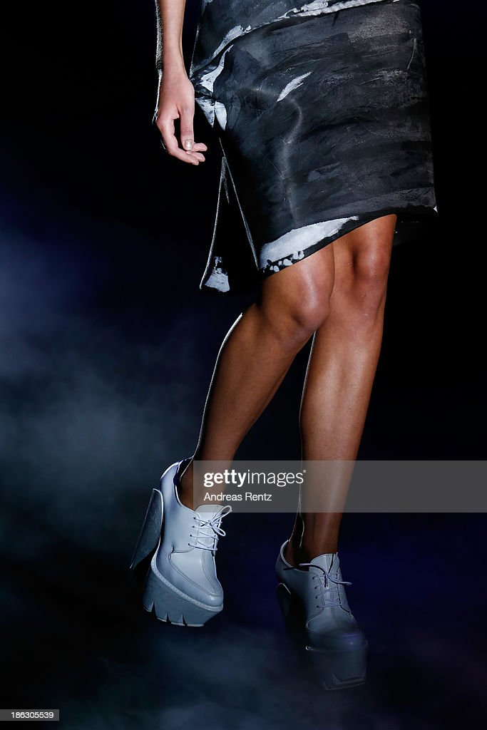 A model walks the runway (detail) at the PIROSMANI BY JENYA MALYGINA show during Mercedes-Benz Fashion Week Russia S/S 2014 on October 30, 2013 in Moscow, Russia.