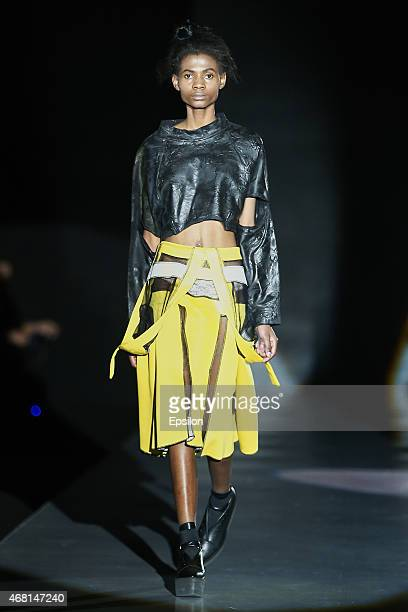 A model walks the runway at the PIROSMANI BY JENYA MALYGINA show during day 5 of Mercedes Benz Fashion Week Moscow at Manege on March 30 2015 in...