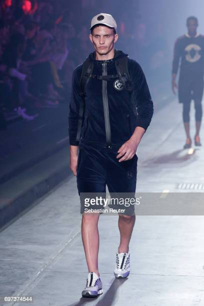 A model walks the runway at the Plein Sport show during Milan Men's Fashion Week Spring/Summer 2018 on June 18 2017 in Milan Italy