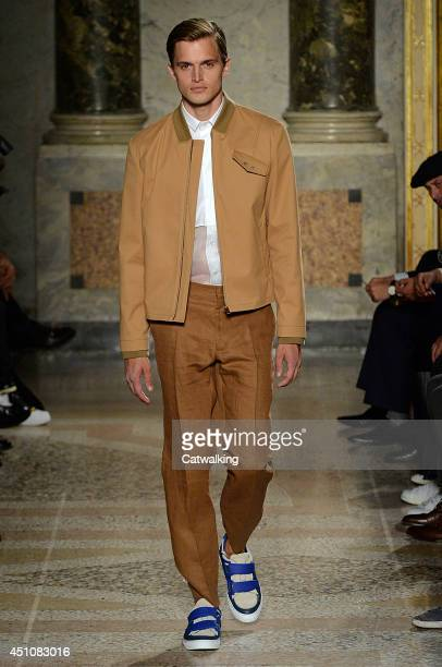 A model walks the runway at the Ports 1961 Spring Summer 2015 fashion show during Milan Menswear Fashion Week on June 23 2014 in Milan Italy
