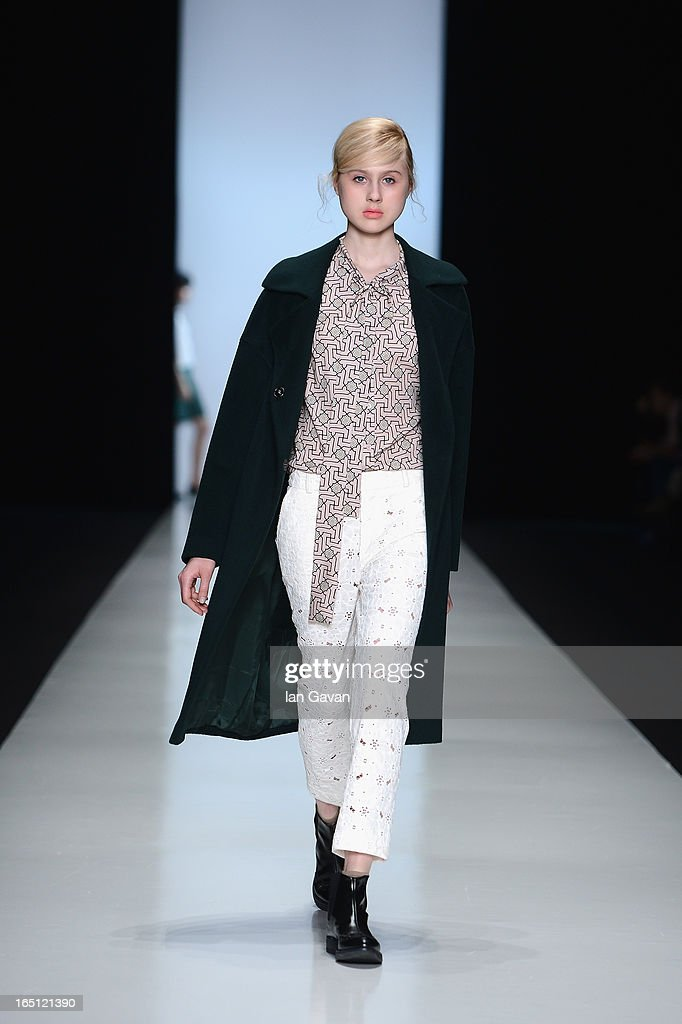 A model walks the runway at the Poustovit show during Mercedes-Benz Fashion Week Russia Fall/Winter 2013/2014 at Manege on March 31, 2013 in Moscow, Russia.