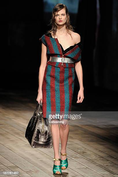 A model walks the runway at the Prada Autumn Winter 2013 fashion show during Milan Fashion Week on February 21 2013 in Milan Italy