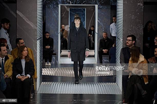 A model walks the runway at the Prada Autumn Winter 2015 fashion show during Milan Menswear Fashion Week on January 18 2015 in Milan Italy