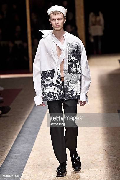 A model walks the runway at the Prada Autumn Winter 2016 fashion show during Milan Menswear Fashion Week on January 17 2016 in Milan Italy