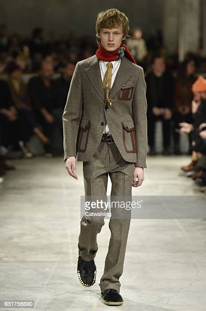 A model walks the runway at the Prada Autumn Winter 2017 fashion show during Milan Menswear Fashion Week on January 15 2017 in Milan Italy