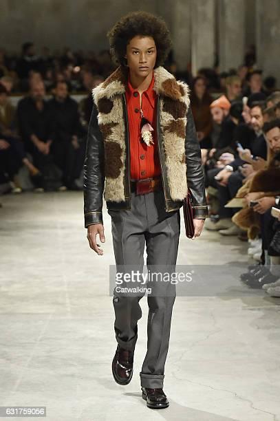A model walks the runway at the Prada Autumn Winter 2017 fashion show during Milan Menswear Fashion Week on January 15 2017 in Milan Italy