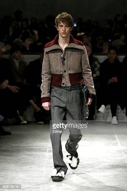 A model walks the runway at the Prada designed by Miuccia Prada show during Milan Men's Fashion Week Fall/Winter 2017/18 on January 15 2017 in Milan...