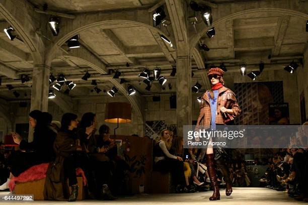 A model walks the runway at the Prada show during Milan Fashion Week Fall/Winter 2017/18 on February 23 2017 in Milan Italy