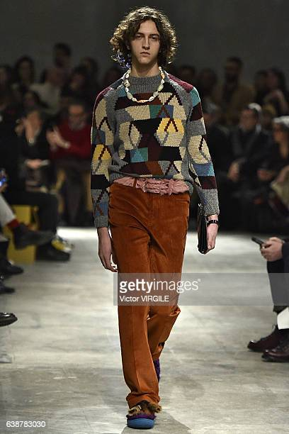 A model walks the runway at the Prada show during Milan Men's Fashion Week Fall/Winter 2017/18 on January 15 2017 in Milan Italy