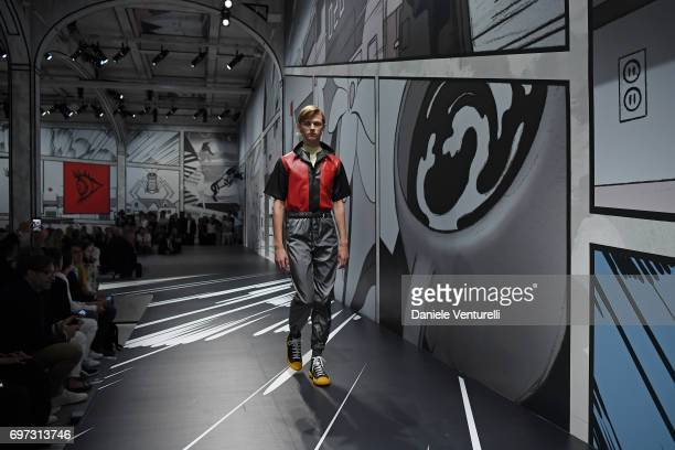 A model walks the runway at the Prada show during Milan Men's Fashion Week Spring/Summer 2018 on June 18 2017 in Milan Italy