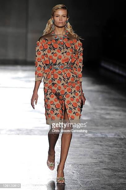 A model walks the runway at the Prada Spring Summer 2012 fashion show during Milan Fashion Week on September 22 2011 in Milan Italy