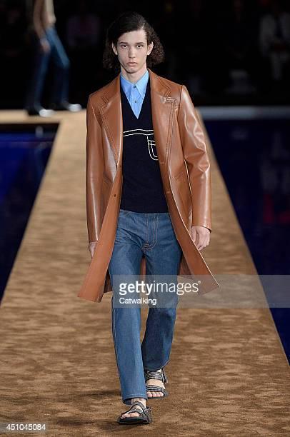 A model walks the runway at the Prada Spring Summer 2015 fashion show during Milan Menswear Fashion Week on June 22 2014 in Milan Italy
