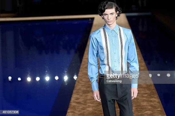 A model walks the runway at the Prada Spring Summer 2015 fashion show during Milan Menswear Fashion Week on June 22 2014 in Milan Italy