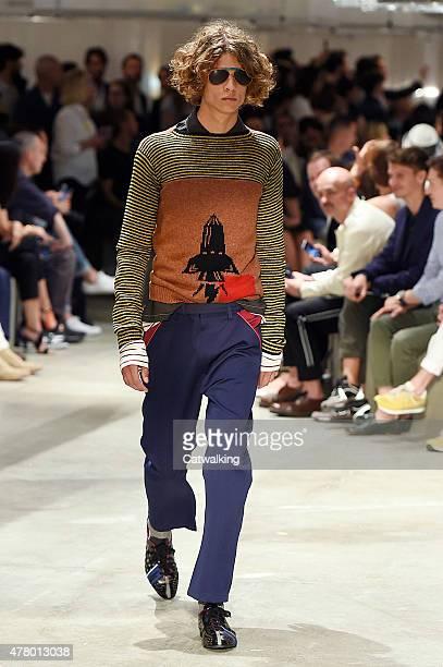 A model walks the runway at the Prada Spring Summer 2016 fashion show during Milan Menswear Fashion Week on June 21 2015 in Milan Italy