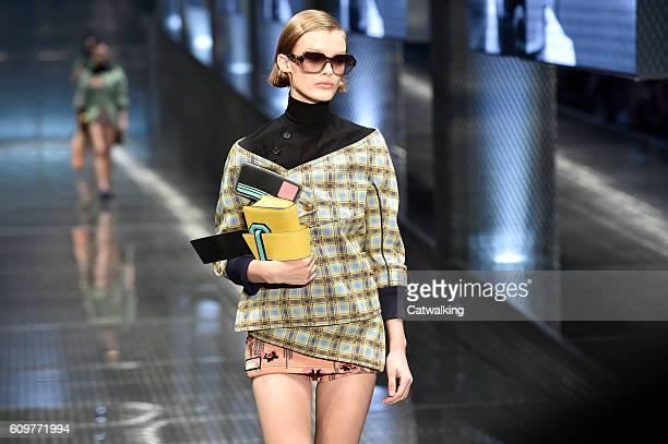 A model walks the runway at the Prada Spring Summer 2017 fashion show during Milan Fashion Week on September 22 2016 in Milan Italy