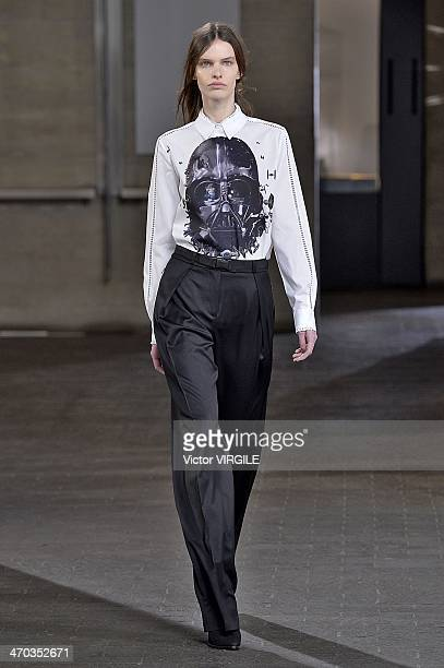 A model walks the runway at the Preen by Thornton Bragazzi Ready to Wear Fall/Winter 20142015 show at London Fashion Week AW14 at on February 16 2014...