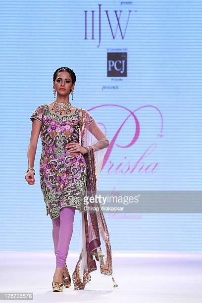 A model walks the runway at the Prisha show on day 4 of India International Jewellery Week 2013 at the Hotel Grand Hyatt on August 7 2013 in Mumbai...