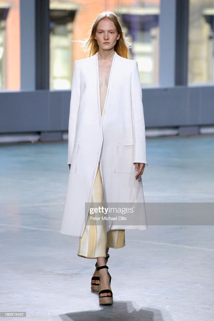 A model walks the runway at the Proenza Schouler fashion show during Mercedes-Benz Fashion Week Spring 2014 at Skylight Ltd on September 11, 2013 in New York City.